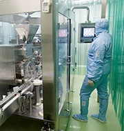 Worker manages VOCs in a pharmaceutical manuacturing plant.